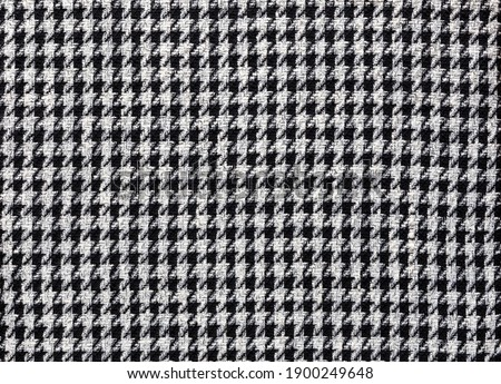 Fashionable fabric made of wool with pepita pattern in black and off-white, textile background image Foto stock ©