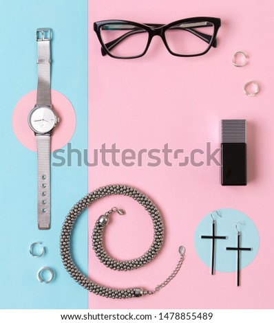 Fashionable female accessories watch, glasses, earrings, perfume, rings and necklace with copy space. Minimal style. Fashion blogger concept
