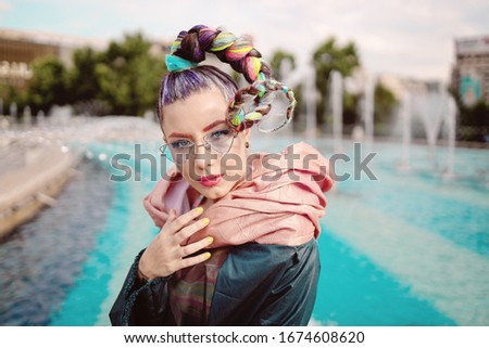 Fashionable Funky Girl Portrait with an extravagant look on streets. Woman with avant garde hairstyle Stock fotó ©