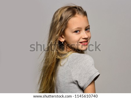 fashionable girl. fashionable girl on grey background, copy space. fashionable girl with long hair. fashionable girl smiling and looking great