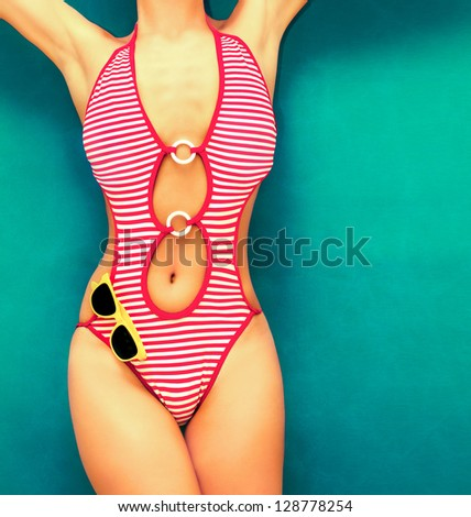 fashionable girl in a swimsuit on the water