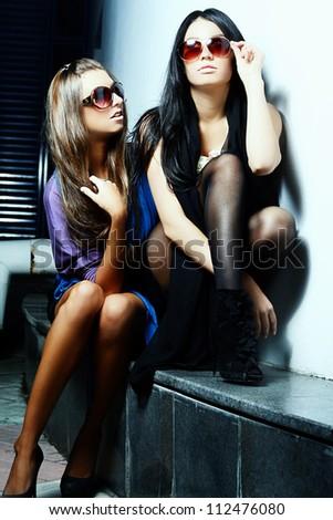 fashionable girls in sunglasses
