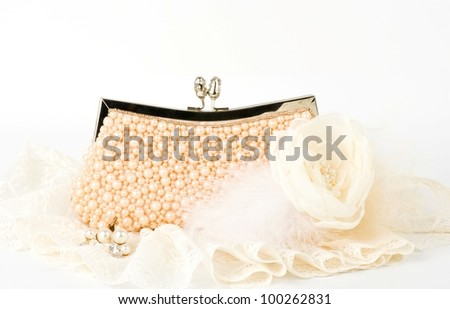 Fashionable handbag with pearls and laces on white background. - stock photo