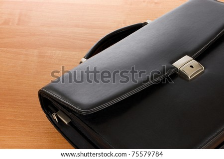 Fashionable leather briefcase on a table