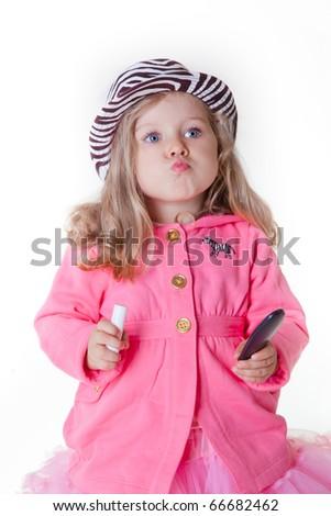 Fashionable little girl sending a kiss