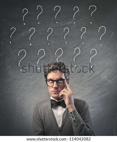 Fashionable man having many doubts