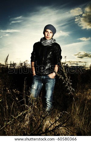 Fashionable man in field of photo shooting on nature