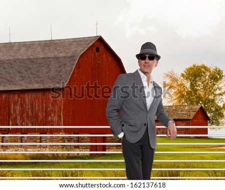 Fashionable man standing in from of a red barn  #162137618