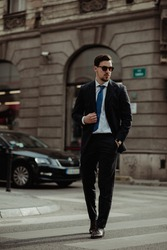 Fashionable man wearing classy suits in the city surrounding