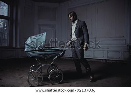 Fashionable man with a perambulator
