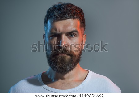 Fashionable man with short hair in casual wear. Serious man with beard and mustache. Portrait closeup of handsome unshaven man. Cool bearded man in white t-shirt. Natural confident portrait concept.