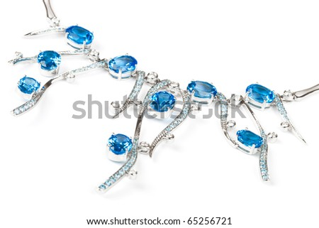 fashionable necklace with sapphires on a white background