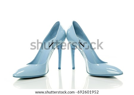 Fashionable Pair of Shoes on high Heels. Woman Shoes Isolated on the White Background. High Heel Shoes
