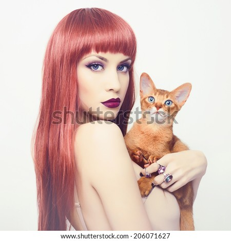 Fashionable photo of elegant lady with Abyssinian cat #206071627