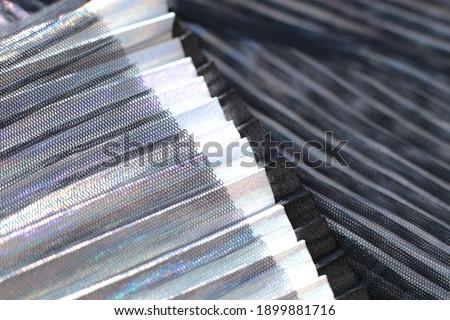 Fashionable pleated fabric close-up background, texture like accordion