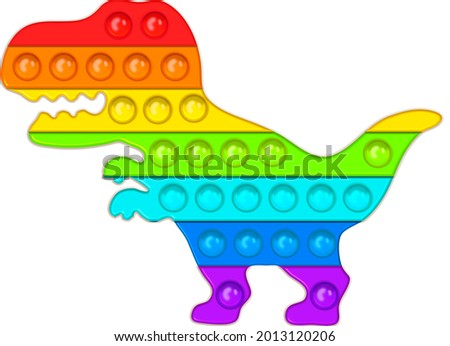 Fashionable pop-it the shape of a dinosaur. Colorful anti-stress toys in the shape of animals. Push the bubbles with a handmade toy for children. Anti-stress for adults. Sensory fidget in the colors o Foto stock ©