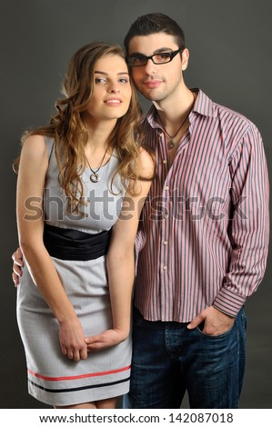 fashionable portrait of beautiful girl with long hair and boy. magnetic jewelry and beauty