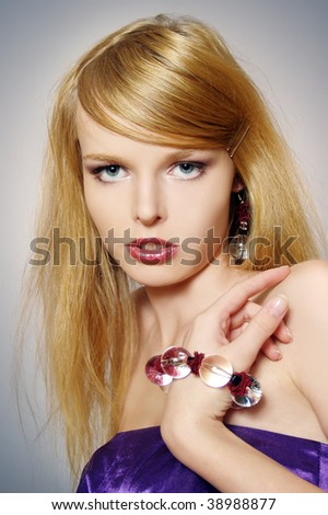 Fashionable portrait of the young sexual woman with accessories - stock photo