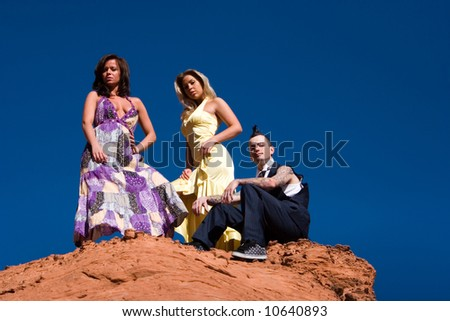 stock photo : Fashionable sexy girls and fashionable male with mohawk