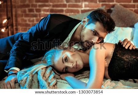 Fashionable shot of an attractive, young couple in the bedroom #1303073854