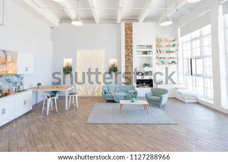 Fashionable spacious apartment with a stylish design in green, grey and white pastel colors with big window and decorative walls #1127288966