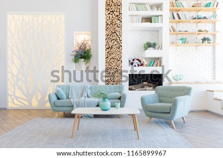 Fashionable spacious apartment with a stylish design in green, grey and white pastel colors with big window and decorative walls. bedroom and kitchen space