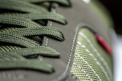 fashionable Stylish sneaker close-up texture of sports shoes knotted laces on gumshoes