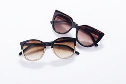 Fashionable sunglasses on white background