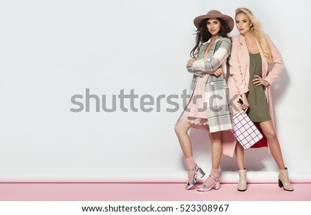 Fashionable two women in coat and nice dress. Fashion autumn winter photo #523308967