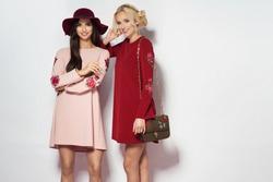 Fashionable two women in nice dresses. Fashion autumn winter photo