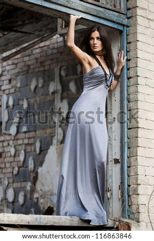 fashionable woman at the grunge window