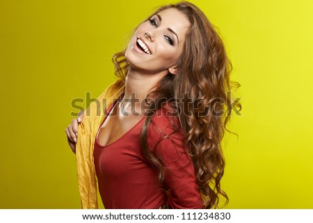 fashionable woman in a autumn color in light background