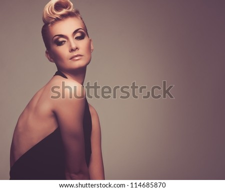 Fashionable woman in black with creative hairstyle