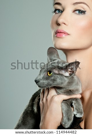fashionable woman with cat