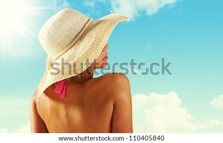 Fashionable woman with straw hat protects from sun #110405840