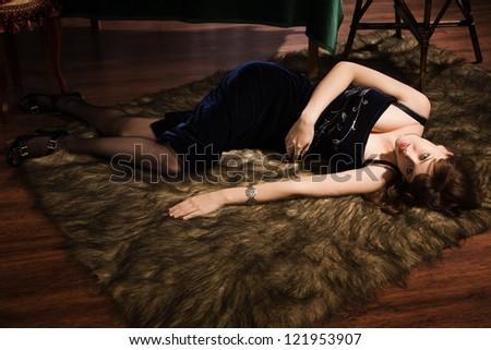 Fashionable women lying on a table in a luxury boudoir