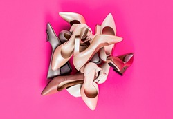 Fashionable women shoes isolated on pink background. View from above. Shoe for women.
