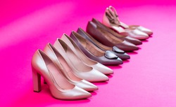 Fashionable women shoes isolated on pink background. View from above. Shoe for women. Stylish classic women leather shoe. High heel women shoes on red background.