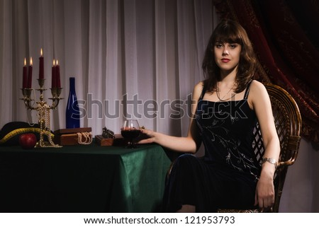 Fashionable women with red wine glass in a hand - stock photo