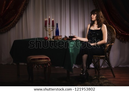 Fashionable women with red wine glass in a hand