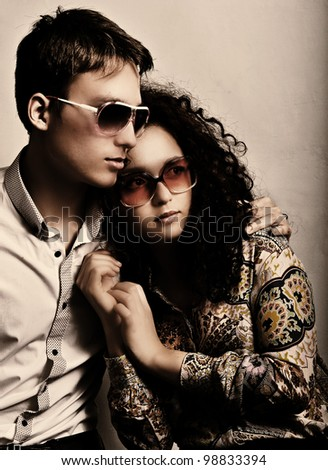 Fashionable young couple - stock photo