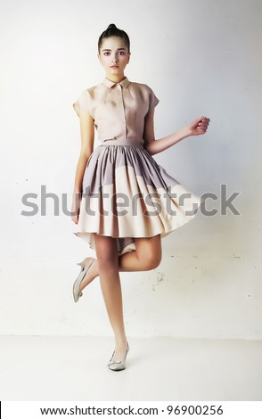 Fashionable young female in contemporary short dress. Studio shot - stock photo