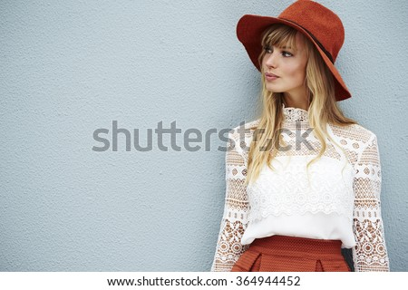 Fashionable young model looking away