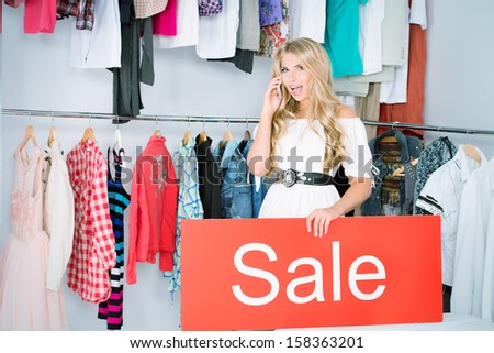 Fashionable young woman shopping in a clothing store. Sale.