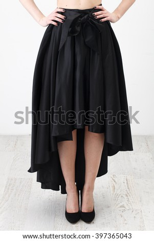 a038ed0e78 Fashionista in black shirt and long skirt on white background #397365043