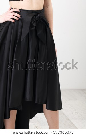 3aeef38033 Fashionista in black shirt and long skirt on white background #397365073