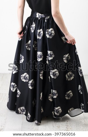 f97ac261a0 Fashionista in black shirt and long skirt with floral print #397365016