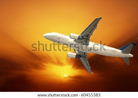 Fast airplane with sunset