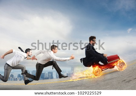 Fast businessman with a car wins against the competitors. Concept of success and competition #1029225529