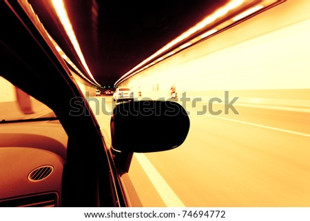 Fast car moving in motion on the street. - stock photo